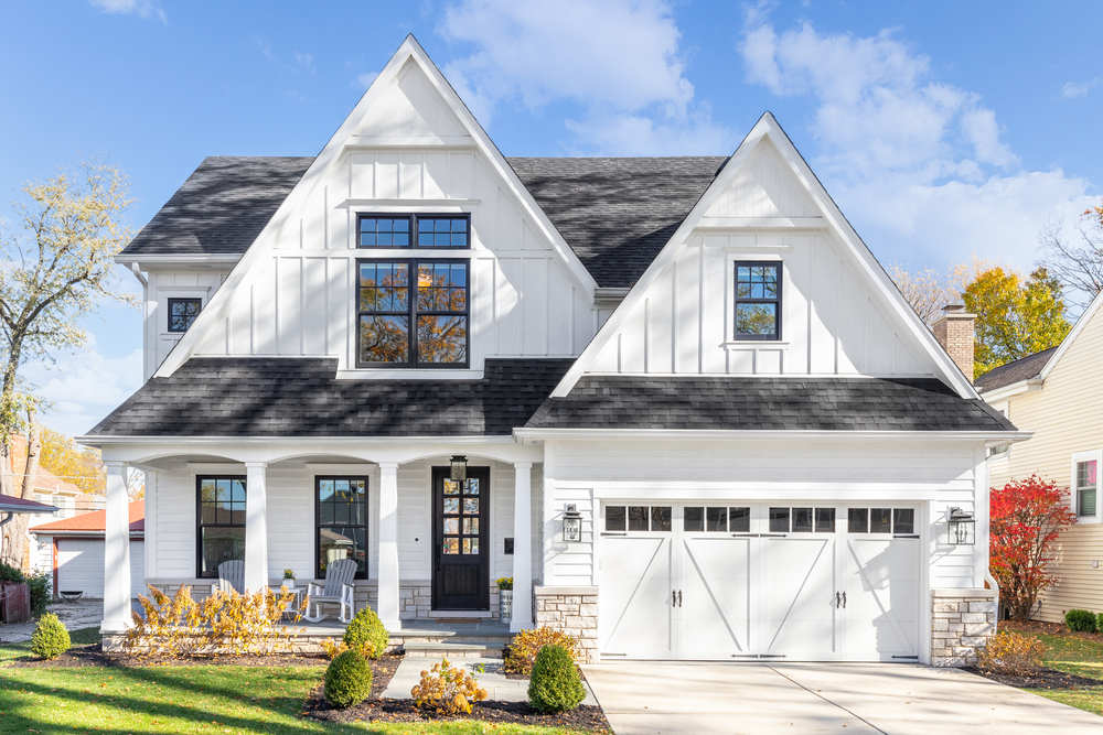 White home with black exterior window frames